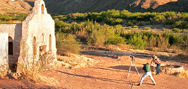 Photo tour clients photographing the Contrabando Movie Set on the Rio Grande